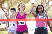 Two Female Runners Finishing Race Together — Stock Photo