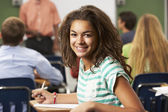 Female Teenage Pupil In Classroom — Stock Photo