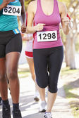 Close Up Of Female Runners In Race — Stock Photo