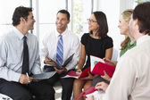 Businesspeople Having Informal Office Meeting — Stock Photo