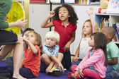 Elementary Pupils In Classroom Learning To Tell The Time — Stock Photo