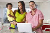 Family Using Laptop In Kitchen Together — Stock Photo