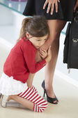 Daughter Clinging To Working Mother's Leg — Stock Photo
