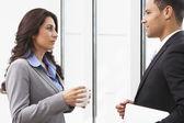 Businesspeople Having Informal Meeting In Office — Stock Photo