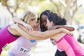 Female Runners Congratulating One Another After Race — Stok fotoğraf