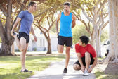 Group Of Male Runners Warming Up Before Run — Stock Photo