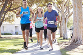 Group Of Runners On Suburban Street — Stock Photo