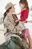 Daughter Greeting Military Mother Home On Leave — Stock Photo