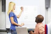Female Student Writing Answer On Whiteboard — Stock Photo