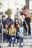 Group Of Teenage Pupils Outside Classroom With Teacher — Stock Photo