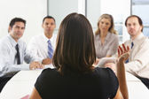View From Behind As CEO Addresses Meeting In Boardroom — Stock Photo