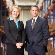 Stock Photo: BusinesswomAnd BusinessmIn Distribution Warehouse