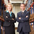 Businesswoman And Businessman In Distribution Warehouse — Stock Photo