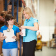 Stock Photo: BusinesswomAnd Female Worker In Distribution Warehouse