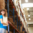 Female Worker In Distribution Warehouse — Stock Photo