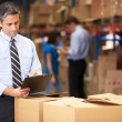 Manager In Warehouse Checking Boxes — Stockfoto