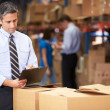 Stock Photo: Manager In Warehouse Checking Boxes