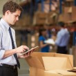 Manager In Warehouse Checking Boxes Using Digital Tablet — Foto Stock