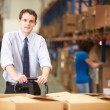 BusinessmPulling Pallet In Warehouse — Stock Photo #36835639