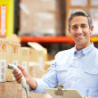 Worker Scanning Package In Warehouse — Stock Photo