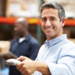 Worker Scanning Package In Warehouse — Stock Photo #36835705