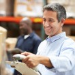 Stock Photo: Worker Scanning Package In Warehouse