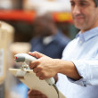 Worker Scanning Package In Warehouse — Stock Photo #36835715