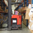 Man Driving Fork Lift Truck In Warehouse — Stock Photo