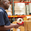 Workers In Warehouse Preparing Goods For Dispatch — Stock Photo #36835763