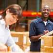Workers In Warehouse Preparing Goods For Dispatch — Stock Photo #36835767
