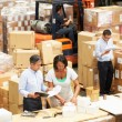 Workers In Warehouse Preparing Goods For Dispatch — Stockfoto