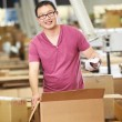 Stok fotoğraf: Worker In Warehouse Preparing Goods For Dispatch