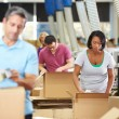 Workers In Warehouse Preparing Goods For Dispatch — Stock Photo