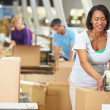 Workers In Warehouse Preparing Goods For Dispatch — Stock Photo #36835919