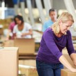 Workers In Warehouse Preparing Goods For Dispatch — Stock Photo #36835945