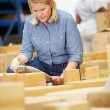 Workers In Warehouse Preparing Goods For Dispatch — Stock Photo #36835997