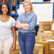 Stock Photo: Portrait Of Workers In Distribution Warehouse