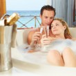 Couple Relaxing In Bath Drinking Champagne Together — Stock Photo