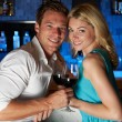 Couple Enjoying Drink In Bar — Stock Photo #36836399