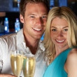 Couple Enjoying Glass Of Champagne In Bar — Stock Photo #36836455