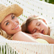 Mother And Daughter Relaxing In Beach Hammock — Stock Photo #36836563