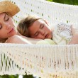 Stock Photo: Mother And Daughter Relaxing In Beach Hammock
