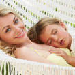 Mother And Daughter Relaxing In Beach Hammock — Stock Photo