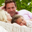 Family Relaxing In Beach Hammock With Sleeping Daughter — Stock Photo #36836589