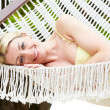 Stock Photo: Woman Relaxing In Beach Hammock