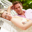 Couple Relaxing In Beach Hammock — Stock Photo