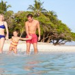 Family Splashing In The Sea On Tropical Beach Holiday — Stock Photo