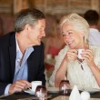 Senior Couple Enjoying Cup Of Coffee In Restaurant — Stock Photo #36836923