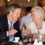 Senior Couple Enjoying Cup Of Coffee In Restaurant — Stock Photo