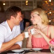Couple Enjoying Cup Of Coffee In Restaurant — Stock Photo #36836945